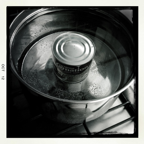 Making the dulce de leche boiling a can of condensed milk