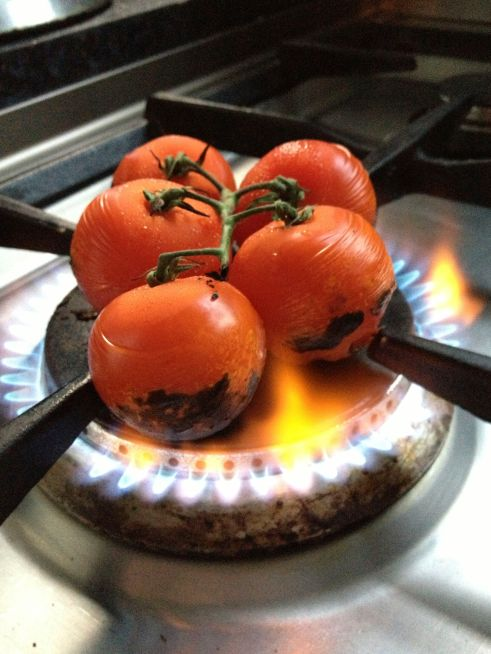 Chargrilling the tomatoes