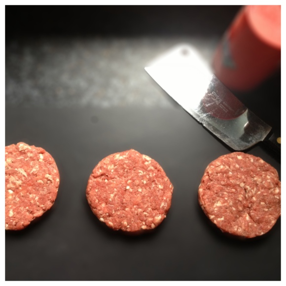 Three burger patties